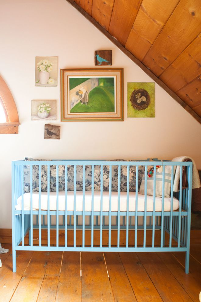 Ikea Gulliver Crib with Farmhouse Nursery  and Arched Window Artwork Light Blue Crib Paintings Rustic Vaulted Ceiling Wood Ceiling Wood Floor