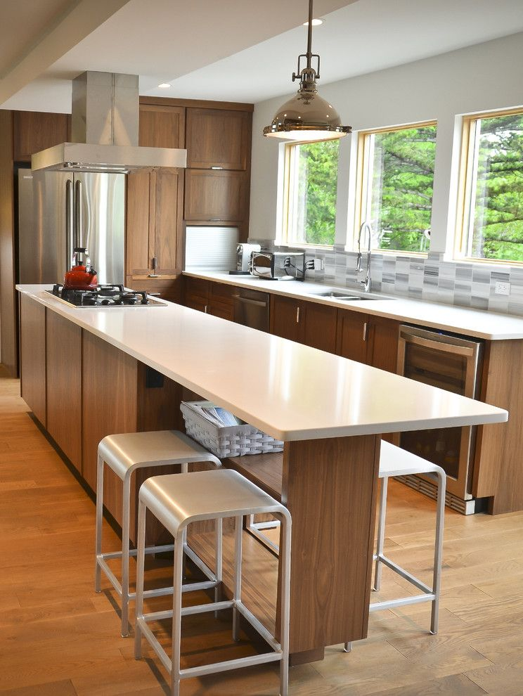 Ikea in Long Island with Contemporary Kitchen  and Bar Stools Caeserstone Counters Counter Stools Island Kitchen Appliances Marble Backsplash Oak Floors Pendant Lighting Wood Floors