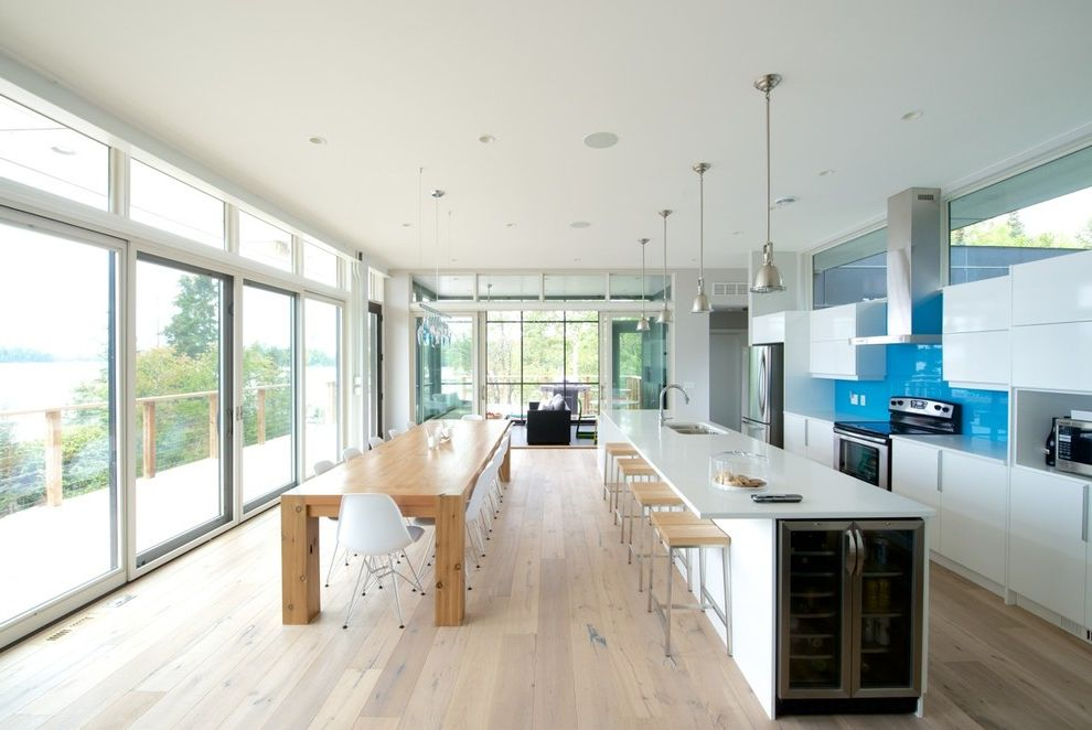 Ikea in Long Island with Modern Kitchen  and Aluminum Pendant Light Blue Backsplash Contemporary Eames Shell Chairs Eat in Kitchen Glass Doors Glass Wall Long Kitchen Island Transom Wine Refrigerator Wood Bar Stools Wood Table