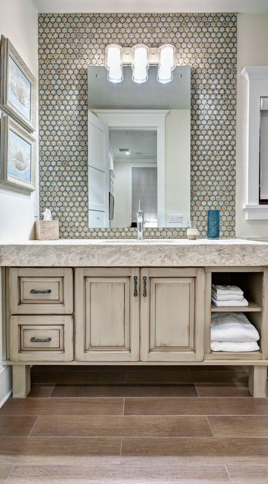 Ikea Jacksonville with Tropical Bathroom  and Bathroom Backsplash Bathroom Storage Bathroom Wall Sconce Distressed Cabinet Distressed Vanity Stone Countertop Tile Floor Towel Storage