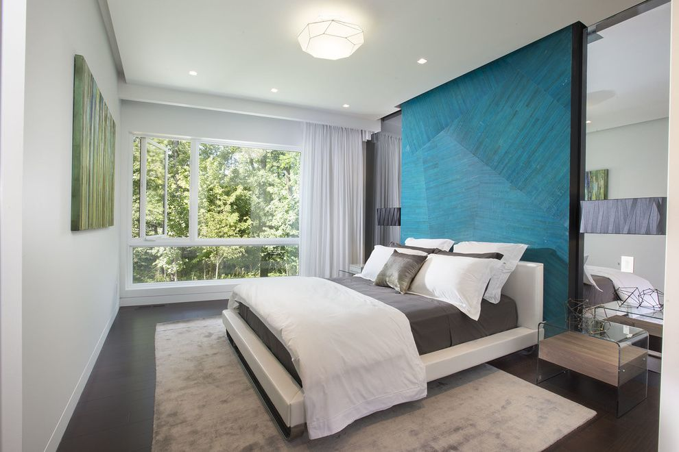 Imax Miami with Contemporary Bedroom and Bedroom Bedroom Design Curtains Gray Area Rug Guest Bedroom Large Bedroom Large Window Mirrored Wall Turquoise Accent Wall White Bed Frame
