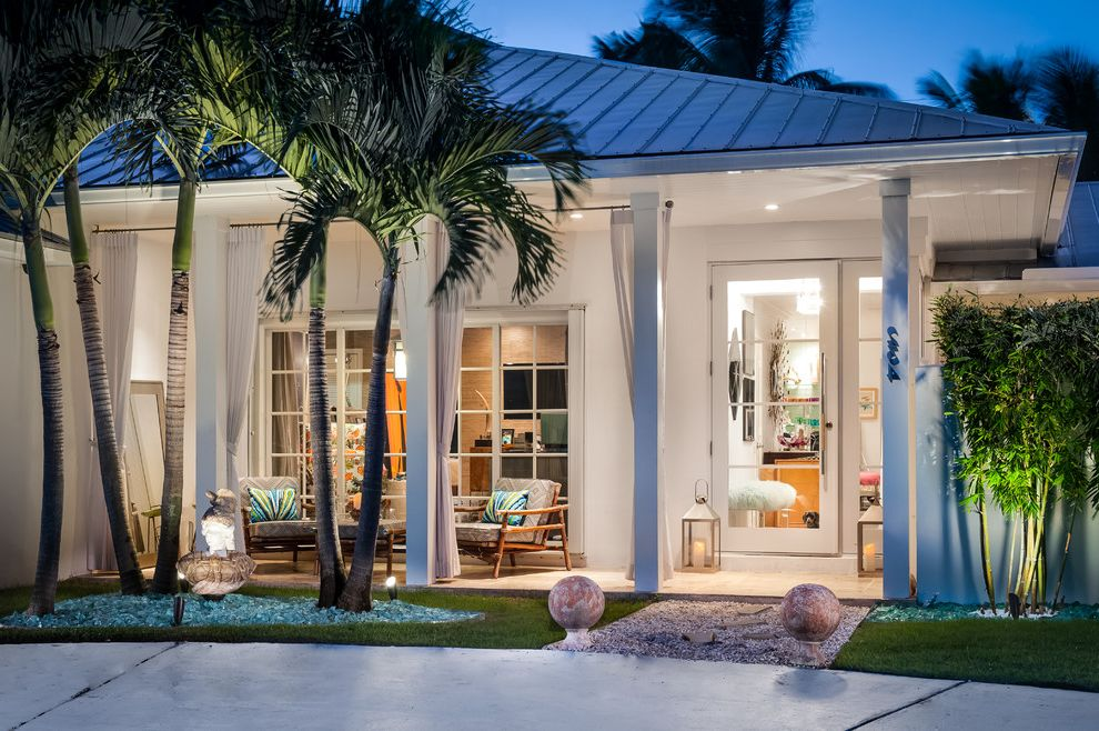 Impact Windows West Palm Beach   Contemporary Exterior  and Beam Covered Entry Glass Front Door Grass Hollywood Regency House Number Lantern Lawn Night Lighting Outdoor Curtains Palm Tree Post Rock Landscape White Exterior White Siding