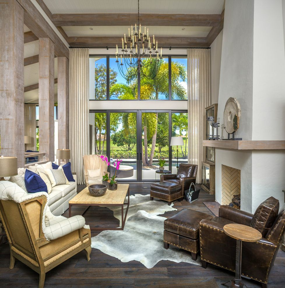 Impact Windows West Palm Beach   Tropical Living Room Also Airy Beams Calm Chandelier Comfy Leather Chairs Cow Hide Rug High Ceilings Neutral Open Concept Pop of Blue