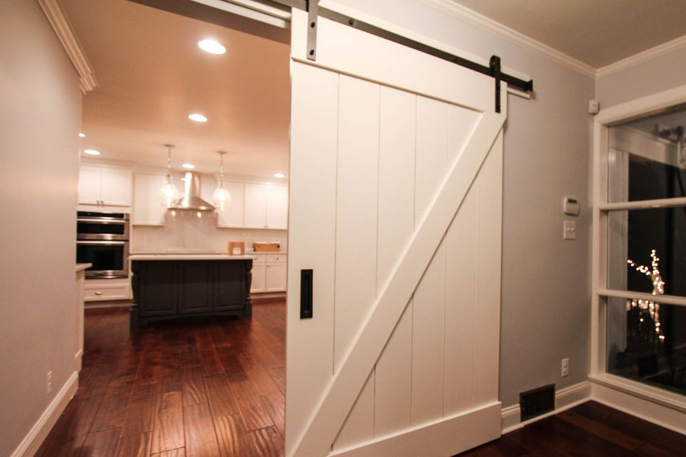 Indoor Barn Doors with Farmhouse Kitchen  and Dremodeling Dura Supreme Cabinetry Farmhouse Gray Island Island Kitchen Modern Scraped Wood Floor Shaker Cabinetry Sliding Barn Doors Tan Two Tone Kitchen White White Kitchen Wood