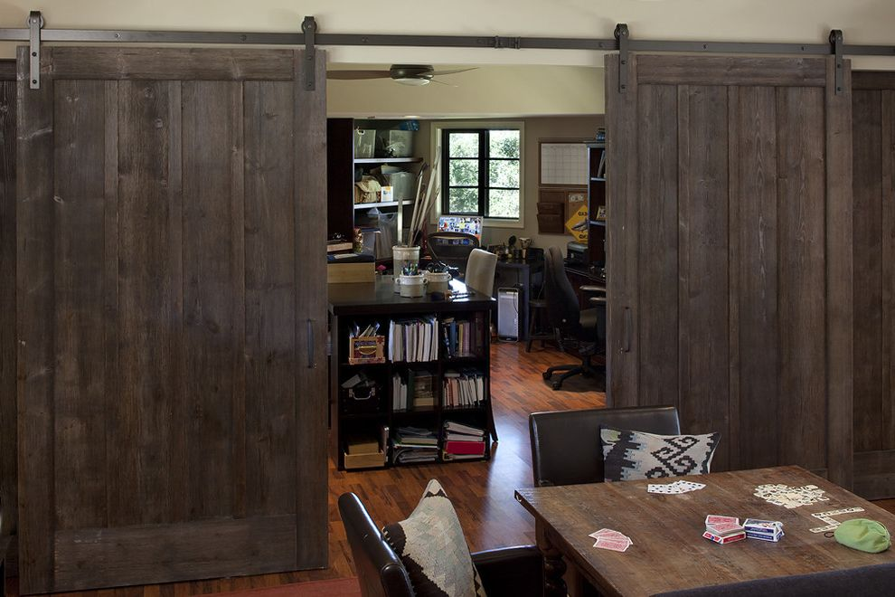 Indoor Barn Doors with Rustic Spaces  and Barn Doors Bookcase Bookshelves Island Neutral Colors Room Dividers Rustic Sliding Doors Storage Studio Wood Flooring