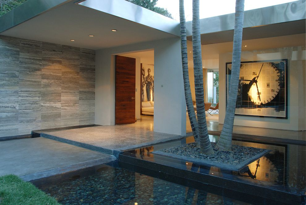 Indoor Water Park Grand Rapids Mi   Modern Porch  and Artwork Covered Porch Entry Front Door Glass Wall Gray Tile Wall Landscaping Outdoor Lighting Pond Recessed Lighting Wood Door
