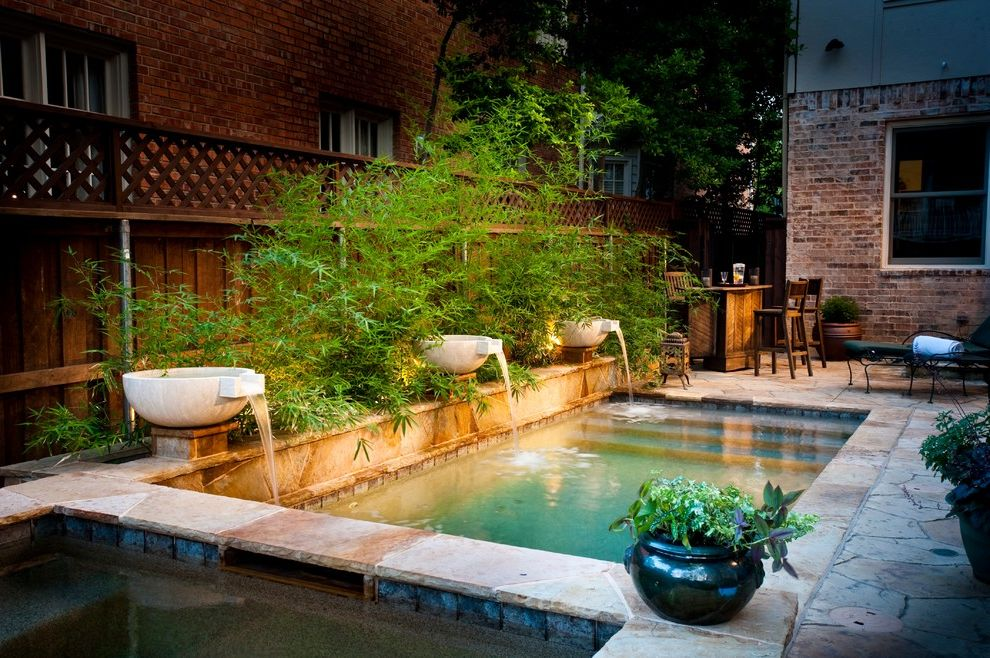 Inground Pool Fountains   Traditional Pool  and Brick House Lattice Fence Outdoor Bar Stools Poolside Patio Potted Plants Rectangular Pool Small Pool Stone Pool Surround Waterfall Wood Bar Stools Wood Fence
