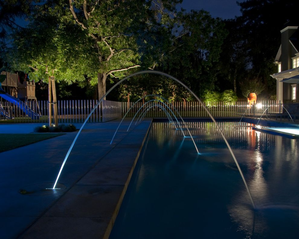 Inground Pool Fountains with Traditional Landscape  and Covered Patio Fence Landscape Lights Patio Play Area Play Structure Pool Pool Deck Concrete Water Feature