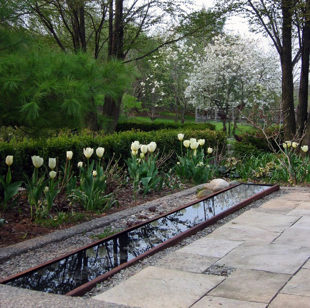 Inground Pool Water Features   Traditional Landscape  and Aquatic Feature Boxwood Flowering Trees Magnolia Patio Pebbles Reflecting Pool Repurposed River Rock Spring Flowers Spring Garden Stone Patio Trough Tulips Water Water Trough White Flowers
