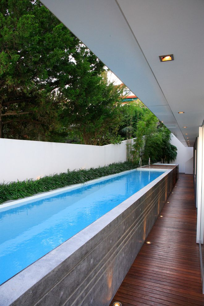 Inground Pools for Sale with Modern Pool Also Above Ground Pool Bamboo Border Plantings Ceiling Lighting Concrete Deck Floor Lighting Garden Wall Geometric Geometry Lap Pool Linear Outdoor Lighting Overhang Recessed Lighting Up Lighting
