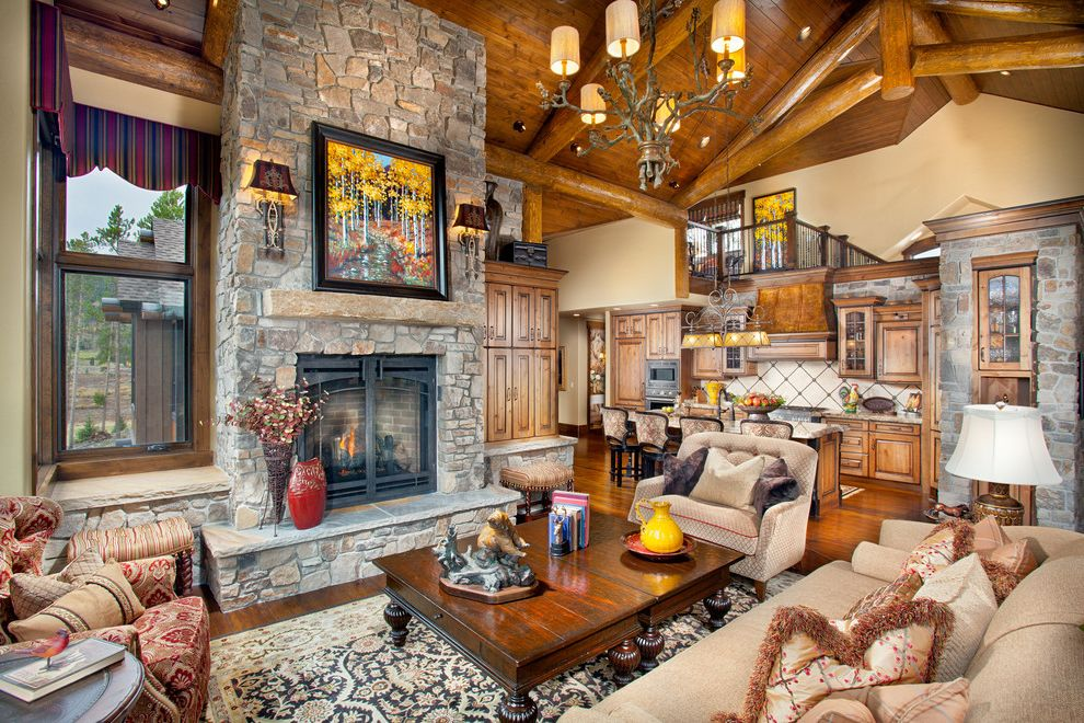 Installing Gas Fireplace Insert with Rustic Living Room  and Beams Fringe Open Kitchen Overstuffed Rustic Rustic Chandelier Sconces Stone Fireplace Stone Wall Throw Pillows Timbers Trusses Valance Wood Ceiling Wood Coffee Table