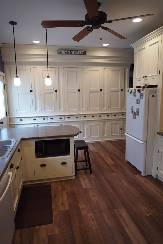 Installing Vinyl Plank Flooring with Farmhouse Kitchen Also Farmhouse Farmhouse Kitchen Grand Rapids Kitchen Kitchen Remodel Laminate Countertop Mission Shaker Thompson Remodeling White Cabinets White Kitchen