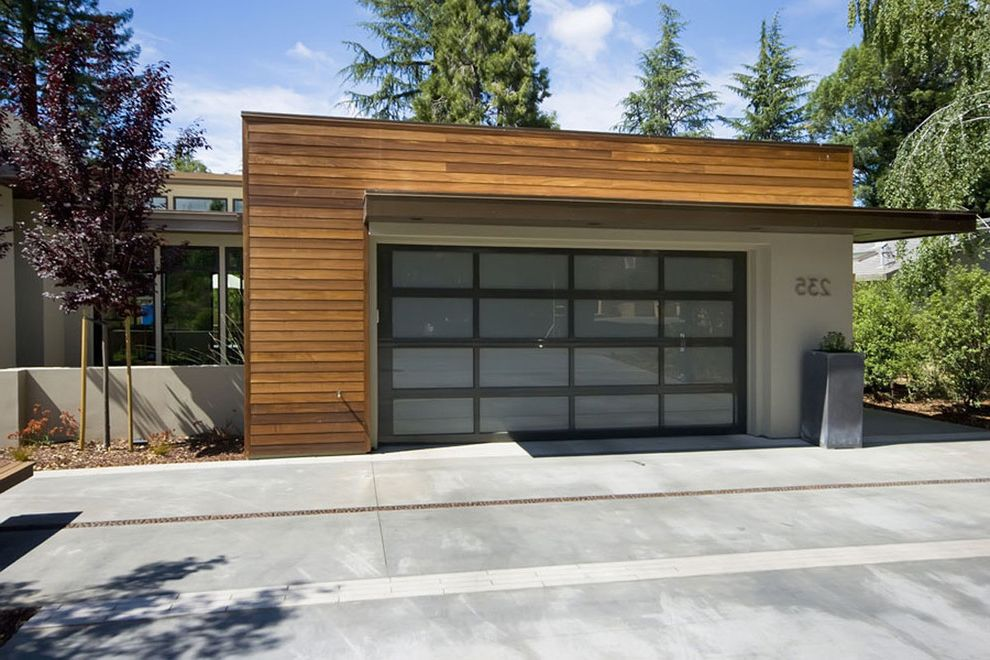 Insulated Glass Garage Doors   Contemporary Garage  and Concrete Paving Container Plants Flat Roof Garage Door Garden Wall House Numbers Overhang Potted Plants Roof Line Wood Siding