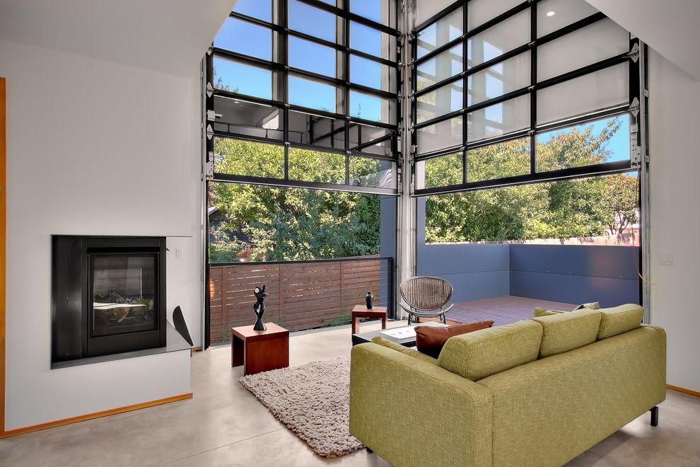 Insulated Glass Garage Doors with Industrial Living Room Also Area Rug Balcony Cable Railing Concrete Floor Corner Fireplace Garage Door Handrail Industrial Loft