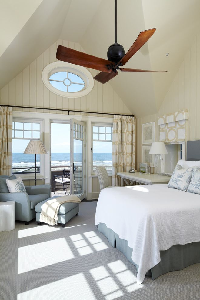 Interior Designers Charleston Sc with Beach Style Bedroom and Armchair Balcony Beach House Beadboard Bed Blue Armchair Carpet Ceiling Curtain Desk Fan Floor Lamp Oval Window Patio Door White and Blue White Carpet White Desk Window Treatment