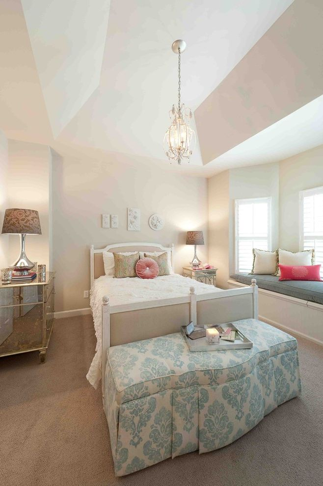 Interior Designers Charleston Sc with Contemporary Bedroom and Beige and White Bed Beige Carpet Blue Patterned Ottoman Chandelier Mismatched Nightstand Nightstand Pink Accent Pillows Table Lamp Tray Vaulted Ceiling White Bedding White Wall Window Seat