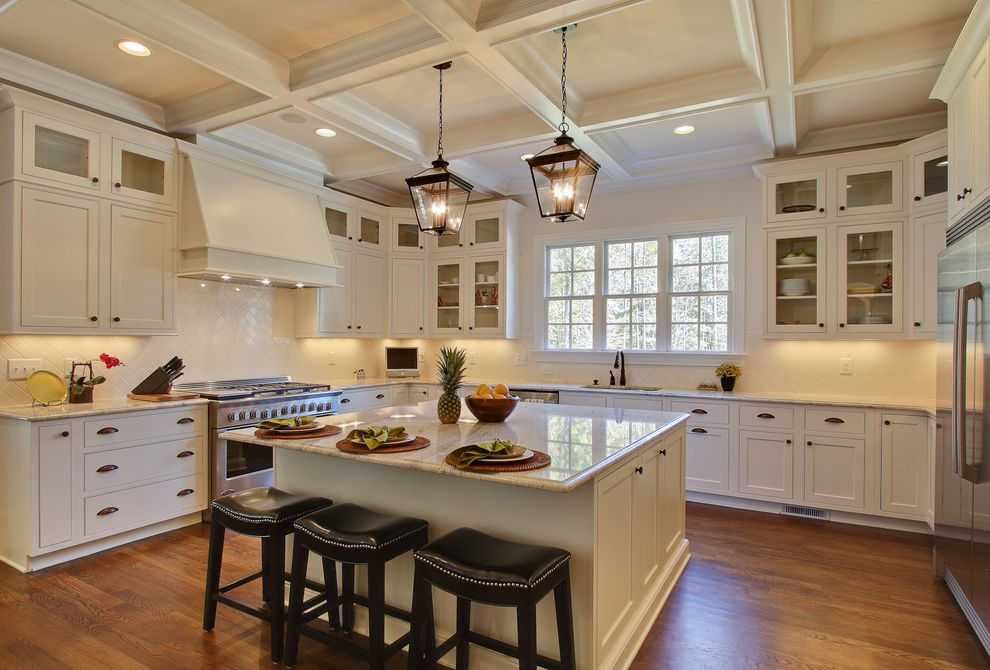 Interior Designers Charleston Sc with Traditional Kitchen and Bin Pulls Coffered Ceiling Glass Cabinet Doors Kitchen Island Lantern Pendant Light Leather Stool Pineapple Shaker Cabinets Tile Backsplash White Vent Hood Wood Cabinets