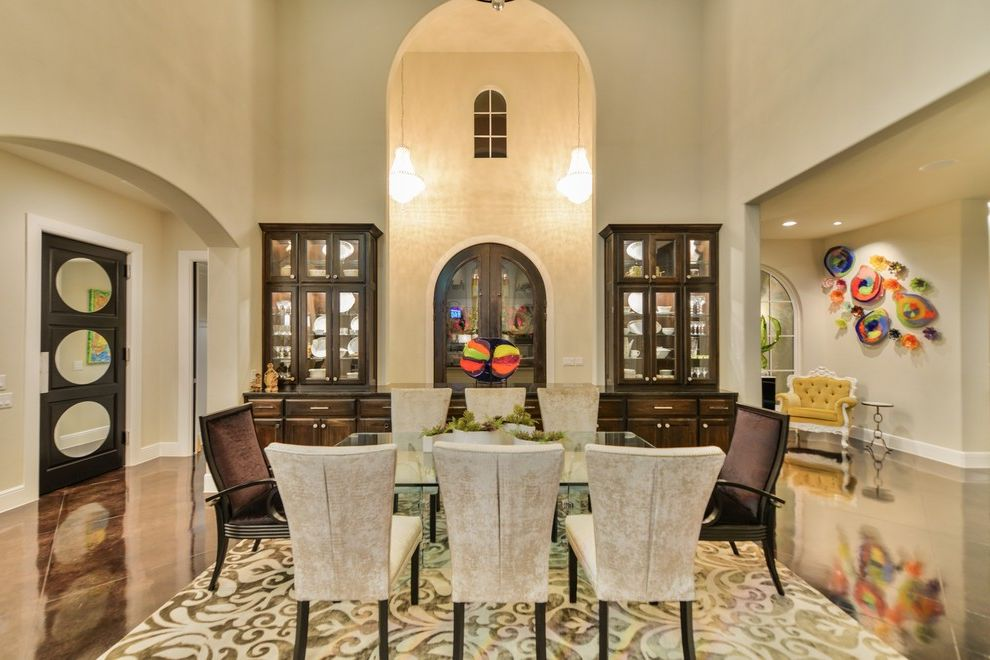 Inverness San Antonio   Contemporary Dining Room  and Area Rug Built in Cina Cabinet Dark Wood Fabric Chair Glass Art Glass Uppers Modern Door Open Niche Open Plan Stained Concrete