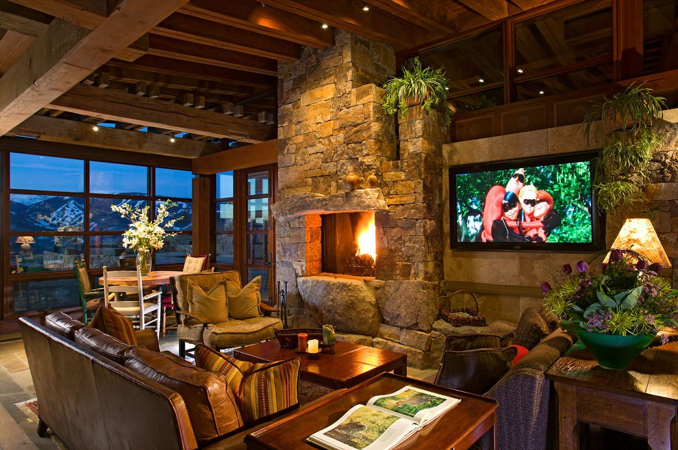 Ion Mount Pleasant with Contemporary Family Room  and Boulders Dark Stained Wood Exposed Rafters Mountain View Rough Hewn Seating Area Stone Fireplace Stone Lintel Tile Floor Timber Frame Wall Mount Tv Wood Beams