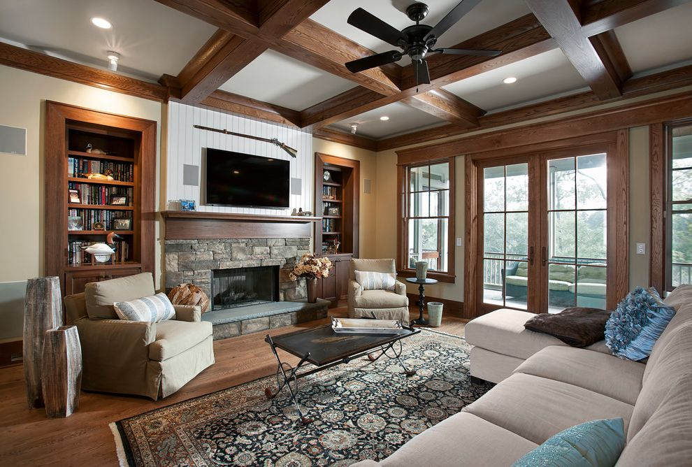 Ion Mount Pleasant with Rustic Living Room  and Beadboard Black Ceiling Fan Built in Shelves Club Chairs Coffered Ceiling French Doors Oriental Rug Sectional Couch Stone Fireplace Stone Hearth Wall Mounted Rifle Wall Mounted Tv Wood Beams