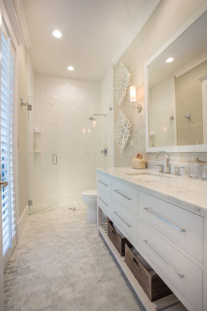Iowa City Plumbers   Transitional Bathroom  and Floridian Villa Glass Shower Doors Golf Course Living Luxurious Cottage Recessed Lighting Tiled Walk in Shower Upscale Cottage Walk in Showers Wall Sconces White Countertop White Shutters Widespread Faucet