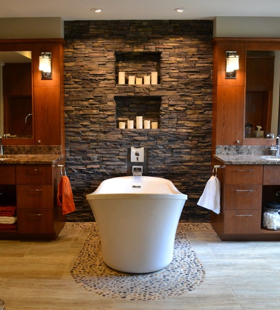 Iowa City Plumbers with Contemporary Bathroom  and Bathroom Mirror Beige Floor Candle Nook Candles Dark Wood Cabinets Dark Wood Drawers Double Bathroom Vanity Freestanding Tub River Rock Floor Stacked Stone Wall Wall Nook Wall Sconce