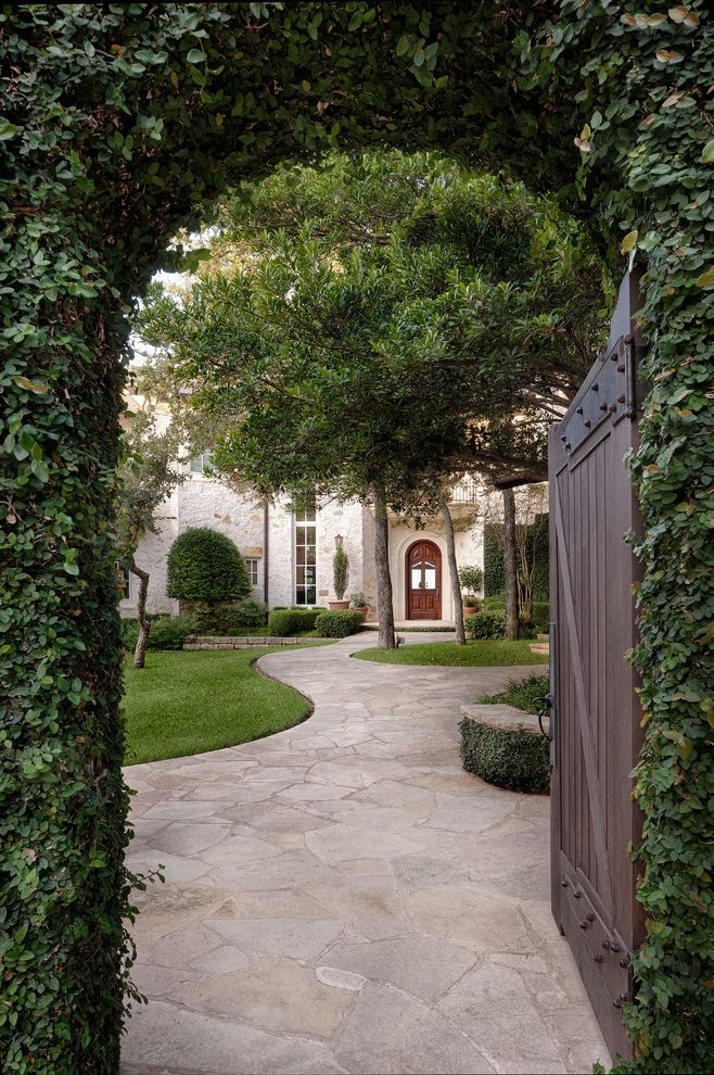 Is Asphalt Cheaper Than Concrete   Traditional Exterior Also Arch Climbing Plant Curved Entry Flagstone Pavers Front Door Grass Hardware Hedges Landscaping Lawn Path Stacked Stone Retaining Wall Topiary Tree Walkway Wood Gate