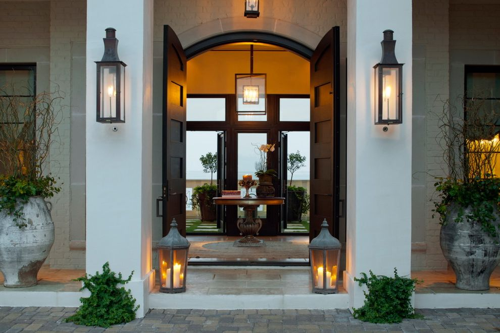 Japanese Outdoor Lanterns   Contemporary Entry  and Arched Doorway Brick Siding Candles Double Doors Entry Table Front Door Lanterns Night Lighting Outdoor Lighting Pendant Lighting Tall Doors Transom Windows White Columns Wood Paneled Doors
