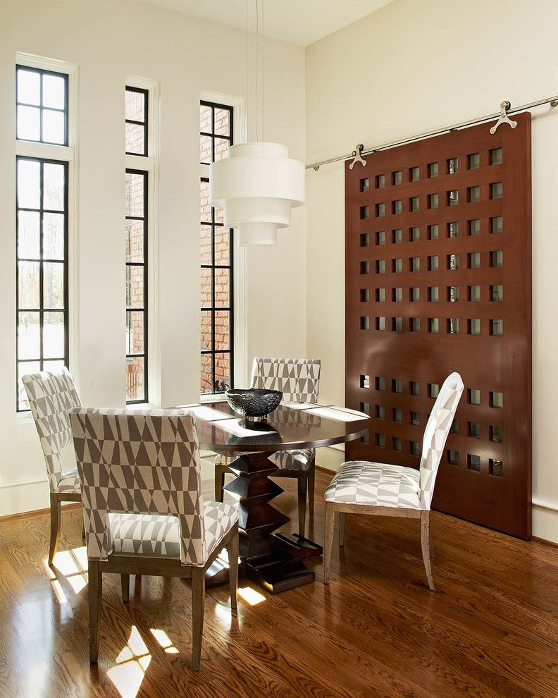 Jeld Weld Windows with Contemporary Dining Room  and High Ceilings Medium Wood Flooring Patterned Dining Chair Round Coffee Table Sliding Barn Door Upholstered Dining Chair Vertical Windows White Ceiling White Pendant Light White Walls Wood Barn Door