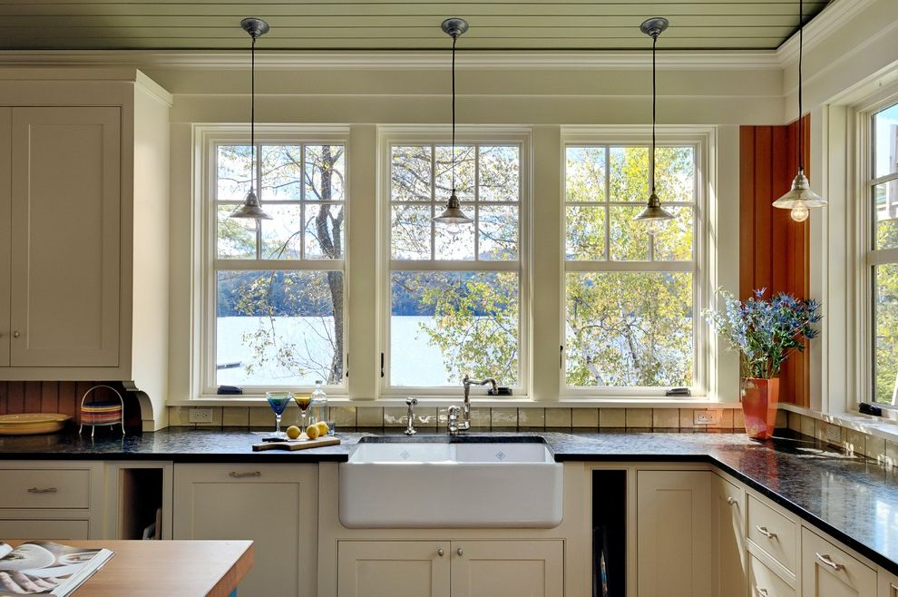 Jen Weld Windows with Rustic Kitchen Also Apron Sink Beadboard Ceiling Black Counters Country Double Hung Windows Farm Farm Sink Frame and Panel Woodwork Green Lake House Pendant Lights Summer House