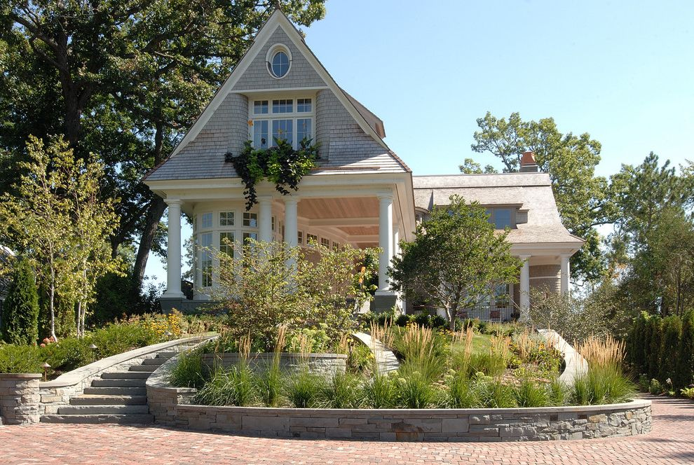 Jen Weld Windows with Victorian Exterior  and Brick Paving Cape Cod Style Columns Cottage Dormer Windows Driveway Grasses Outdoor Stairs Path Planters Retaining Wall Shake Roof Shingle Siding Stone Wall Walkway Window Boxes Wrap Around Porch