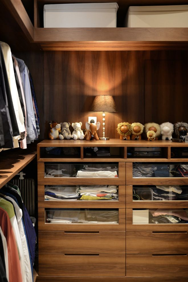 Jerome's El Cajon   Contemporary Closet Also Closet Dark Stained Wood Glass Drawer Fronts Shelves Small Table Lamp Toys Two Layer Clothes Rods Wood Grain