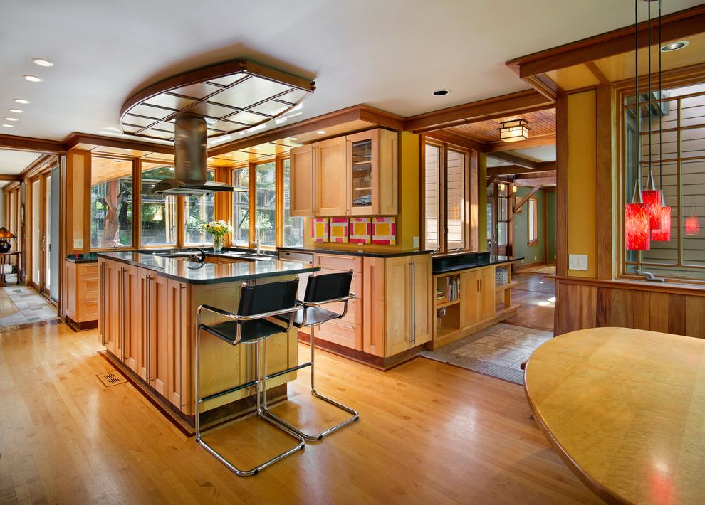 Joe Hayden Realtor with Craftsman Kitchen  and Counter Stools Custom Pops of Color Row of Windows Vent Hood Over Island