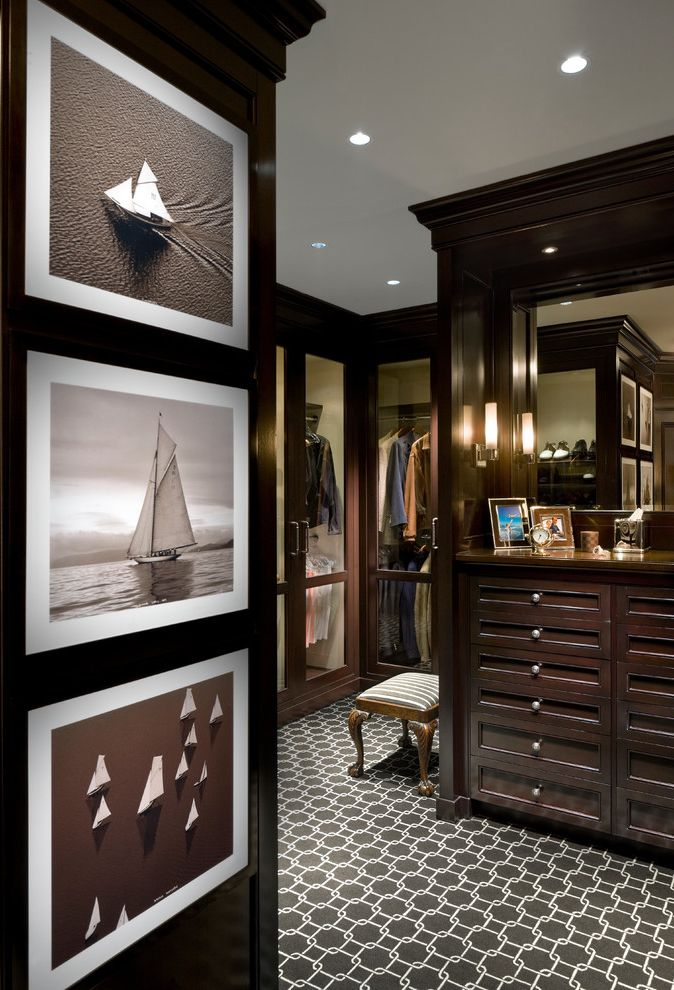 Joes Carpet   Traditional Closet Also Black and White Photography Brown Carpeting Custom Cabinetry Dark Stained Wood Drawers Dressing Room Masculine Mens Dressing Room Mirrors Recessed Lights Sailboats Stool