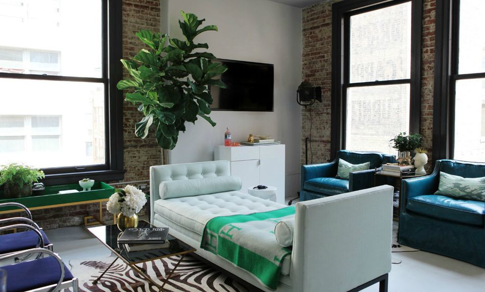 Johnathan Adler   Contemporary Living Room Also Blue Leather Chairs Bolster Pillows Chic Concrete Flooring Dark Trim Day Bed Eclectic Exposed Brick Fiddle Leaf Fig Loft Murphy Bed Wall Mounted Tv Zebra Rug Zebra Skin Rug