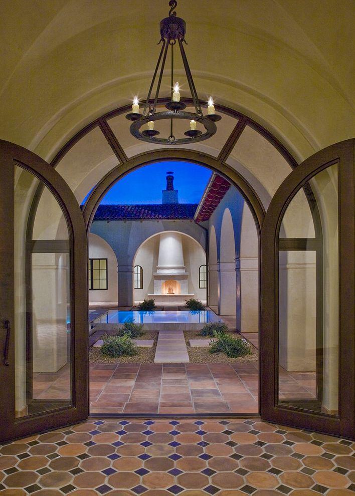 Jon Van Salon   Mediterranean Entry Also Arch Ceramic Floor Courtyard Foyer Geometric Floor Glass Door Iron Chandelier Outdoor Fireplace Pool Round Chandelier Side Lites Spanish Tile Floor