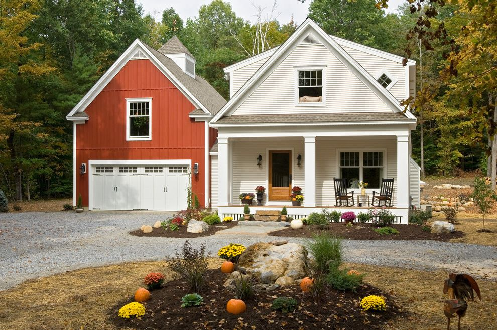 Joy House Milwaukee   Farmhouse Exterior  and Barn Board and Batten Carriage Doors Cupola Detached Garage Entrance Entry Farmhouse Front Door Gable Roof Gravel Driveway Pumpkins Red House Rocking Chairs Rural Rustic Wood Siding