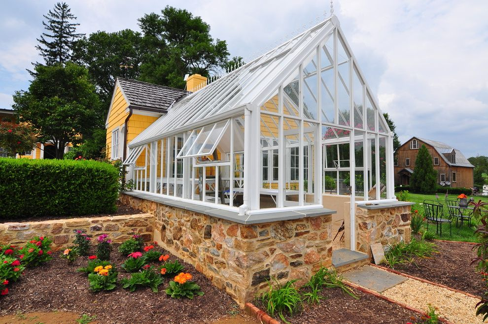 Joy House Milwaukee   Traditional Shed Also Conservatory Glass Roof Flower Bed Grass Greenhouse Roof Hartley Botanic Greenhouse Mulch Orange Flowers Pink Flowers Stone Foundation Wall Yellow House Yellow Siding