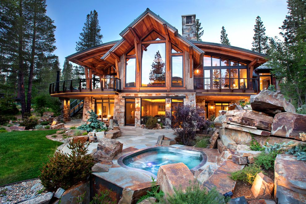 Joy House Milwaukee with Rustic Pool Also Backyard Boulders Cabin Exterior Garden Grass Hardscape Hot Tub Landscape Lawn Patio Pavers Poolside River Rock Rustic Spa Stacked Stone Traditional Trees