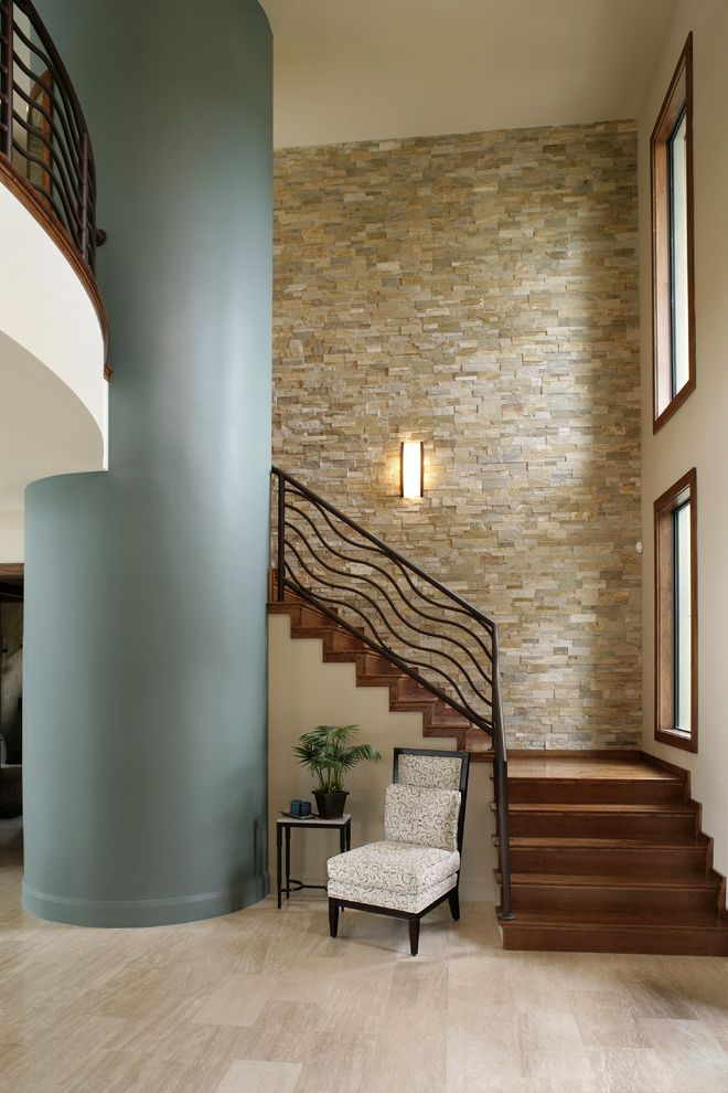 Just Grillin Tampa   Contemporary Staircase Also Accent Table Custom Dark Stained Wood Gray Column Iron Railing Stacked Stone Wall Tile Floor Upholstered Chair Wall Sconce Wood Staircase