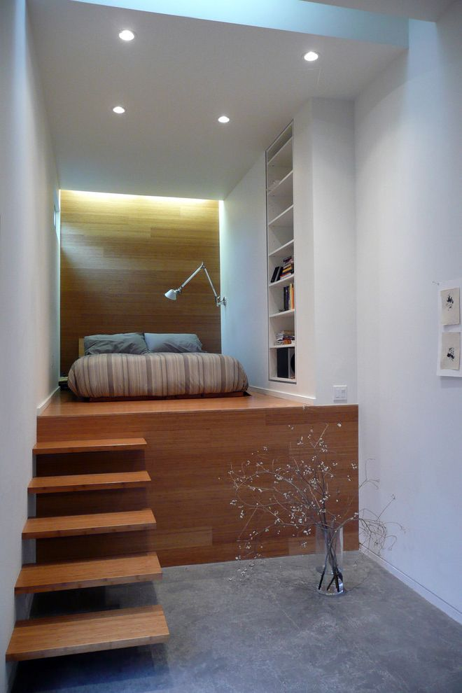 Just Sprinklers   Industrial Bedroom  and Accent Lighting Built in Bookshelf Cement Floor Elevated Bed Floating Wood Stairs Loft Bed Recessed Lighting Vase Wall Lamp White Walls Wood Accent Wall