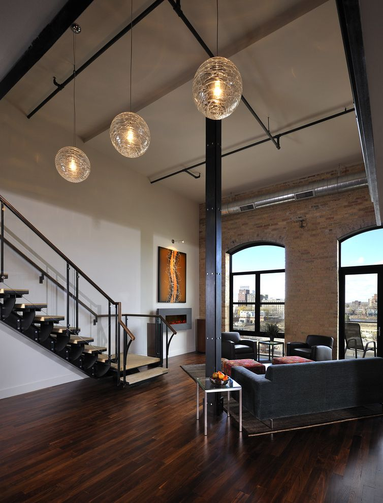 Just Sprinklers   Modern Living Room Also Arched Windows Area Rug Artwork Brick City View Dark Stained Wood Floor Exposed Ducting Firepalce Loft Loft Ceiling Open Staircase Pendant Lights Sofa Vaulted Ceiling