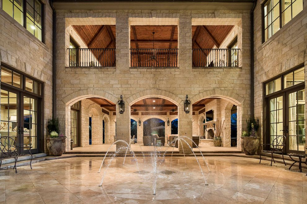 Just Sprinklers   Traditional Patio Also Archway Ceiling Beams Hanging Lantern Lantern Wall Sconce Metal Railing Outdoor Living Outdoor Patio Furniture Potted Plant Stone Exterior Stone Patio Stone Siding Water Feature Wood Ceiling