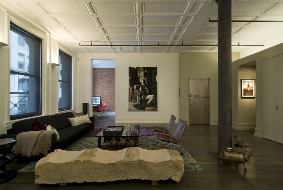 Just Sprinklers with Industrial Living Room  and Art Big City Brick Wall Coffered Ceiling Grey Sofa Industrial Leather Chair Modern Sofa Rug Steel Door Swivel Chair Throw Wood Floor Working Space
