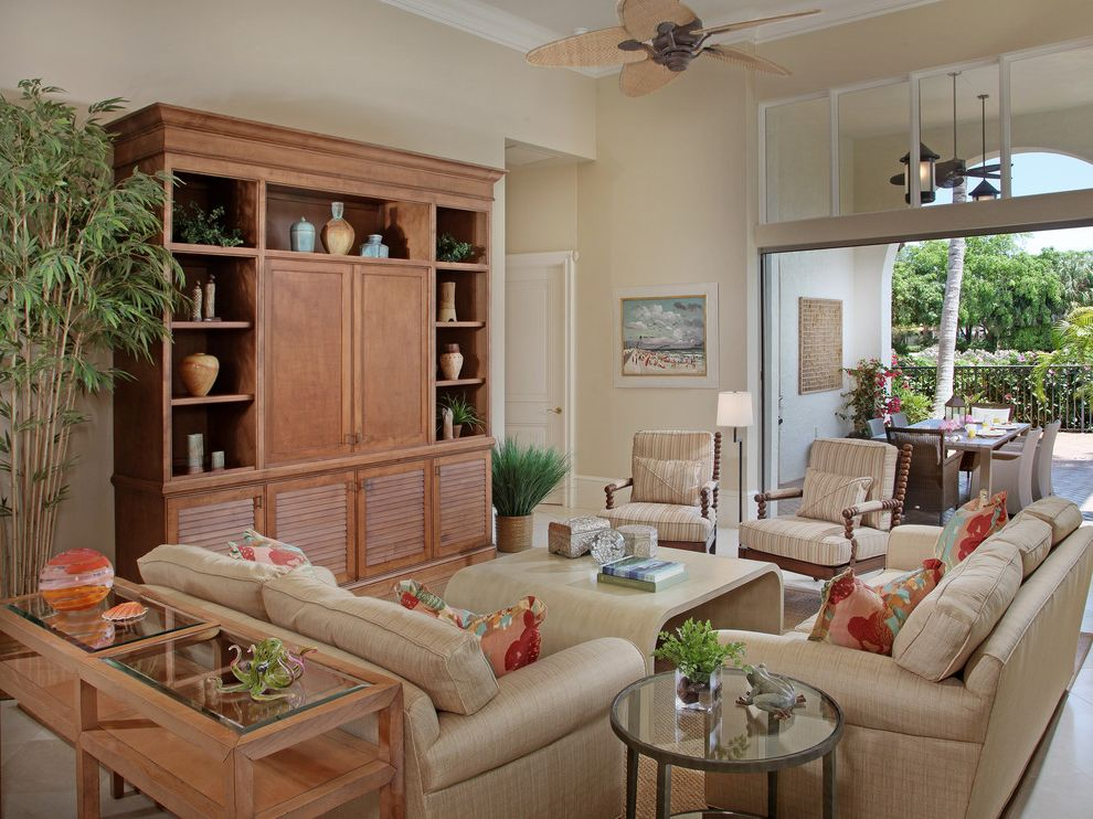 Kanes Furniture Sarasota   Tropical Family Room  and Ceiling Fan Crown Molding Entertainment Center House Plants Media Center Media Storage Neutral Colors Patio Doors Transom White Wood Wood Molding