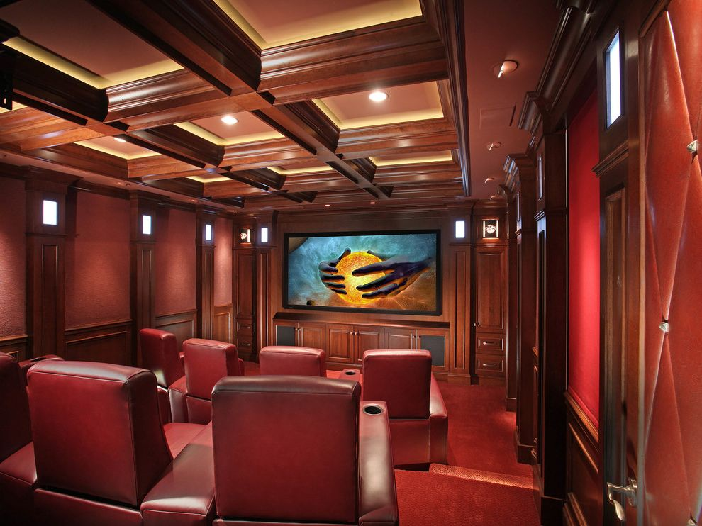 Kb Homes Orlando   Traditional Home Theater Also Built in Cabinets Coffered Ceiling Dark Wood Beams Dark Wood Pilasters Home Theater Recessed Lighting Red Armchairs Red Carpet Theater Room Tiered Seating Wainscoting