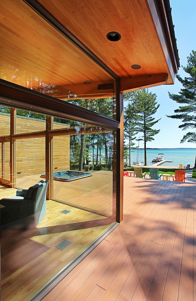 Kc Auto Glass   Modern Exterior Also Cabin Cedar Siding Corner Window Cottage Deck Exposed Beams Flat Roof Floor to Ceiling Glass Garden Furniture Glass Wall Lake Views Modern Post and Beam Spa Wood Ceiling Wood Deck Wood Floor