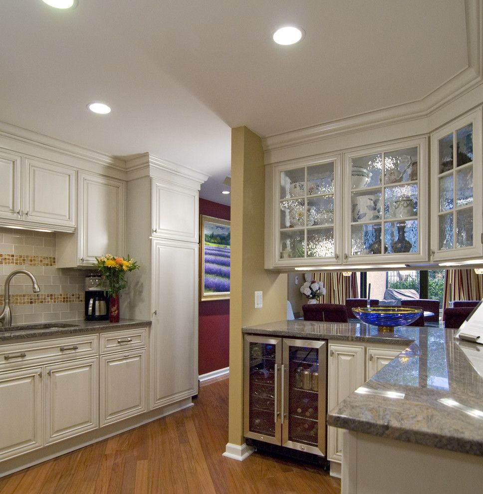 Kc Auto Glass with Contemporary Kitchen  and Baseboards Crown Molding Mosaic Tiles Subway Tiles Tile Backsplash Under Cabinet Lighting White Cabinets White Wood Wine Refrigerator Wood Cabinets Wood Flooring Wood Trim