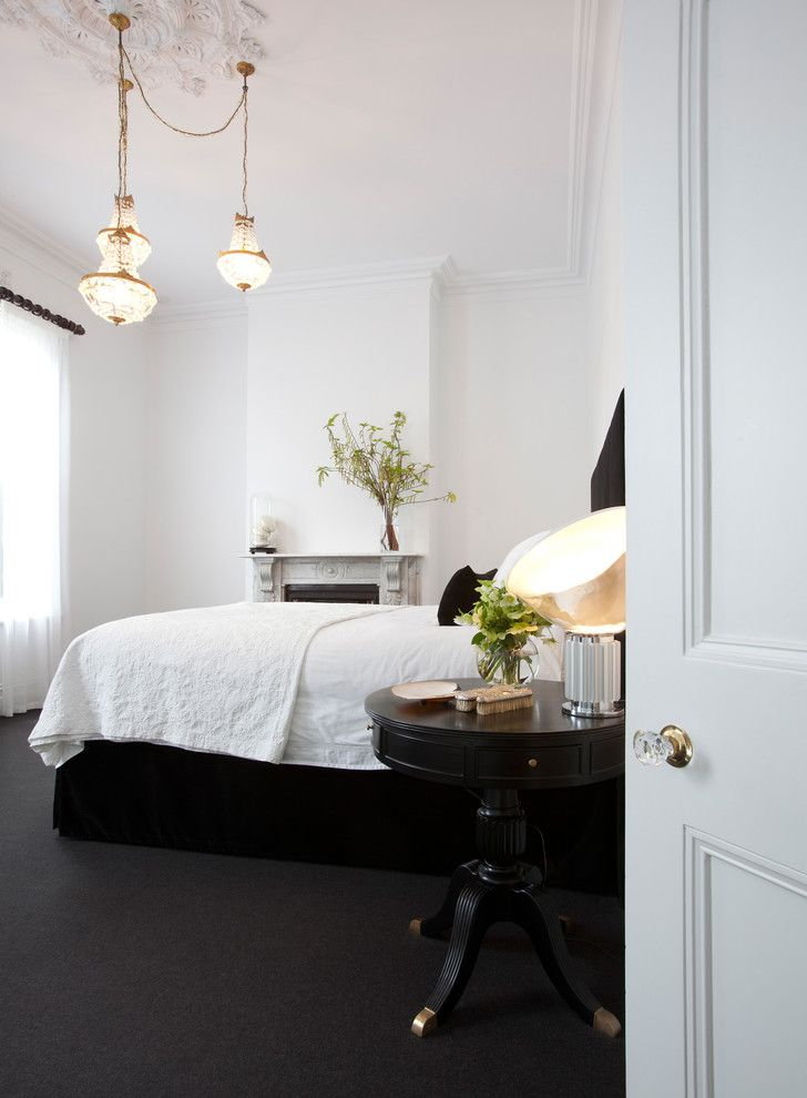 Keep Cat Off Bed with Contemporary Bedroom Also Black and White Ceiling Medallion Chandelier Charcoal Gray Rug Deco Table Lamp Mantel Marble Fireplace Pedestal Table Round Nightstand White Bedding White Coverlet White Drapes