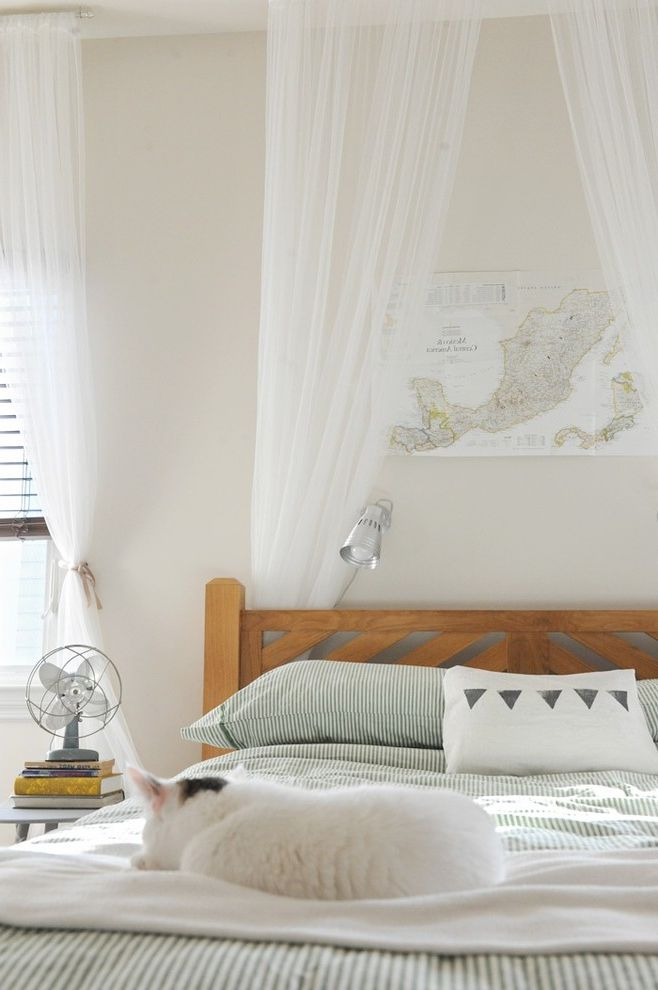 Keep Cat Off Bed with Eclectic Bedroom  and Bed Canopy Electric Fan Map Rustic Striped Bedding Wall Decor Window Sheers Wooden Headboard